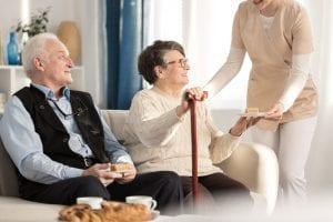Geriatric couple with arthritis sitting