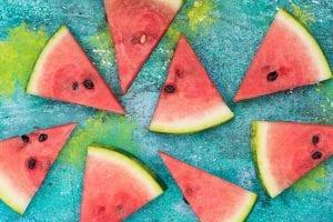 Watermelon slices on vibrant concrete slate