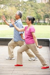 How Can I Strengthen My Joints Naturally | Senior Chinese Couple Doing Tai Chi In Park