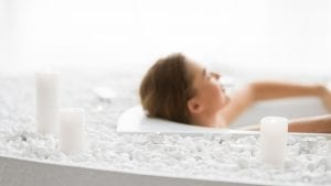 How Can I Strengthen My Joints Naturally | Total relaxation. Woman enjoying hot bath with candles